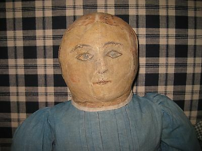 Antique Early Cloth rag doll painted features and primitive blue dress