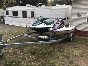 Two Seadoo's and double trailer