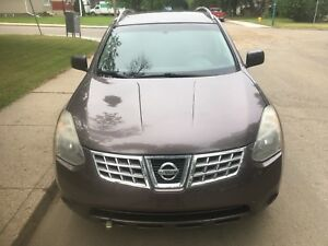 2009 Nissan Rogue (have winter tires on rims)