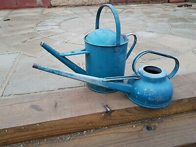 Vintage metal watering can X2 one is a 2 gallon other is 6 pints  no leaks