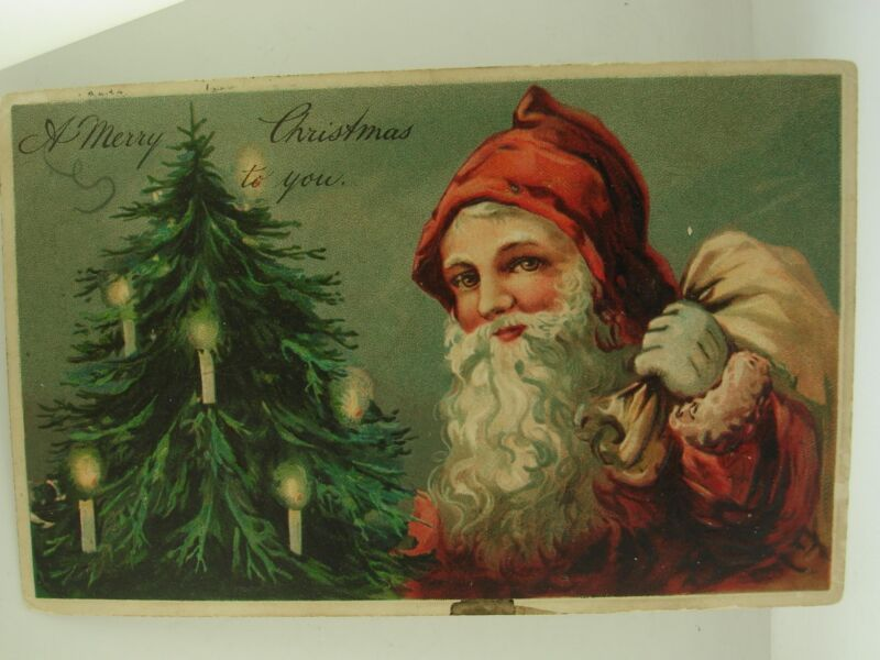 ANTIQUE DTD. 1908 GERMANY EMBOSSED DIVIDED BACK SANTA W/PACK CHRISTMAS CARD!