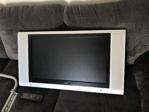 "27"" ACER LCD TV, comes with wall mount and remote."