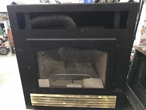 New 7 yr old napoleon fireplace insert never lit