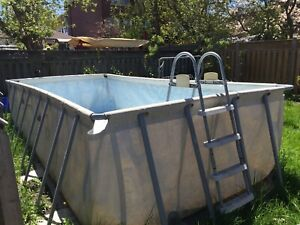 Outdoor above ground swimming pool plus solar heaters