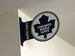 Maple leaf signs