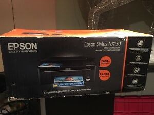 Epson all in one printer great condition in box almost new