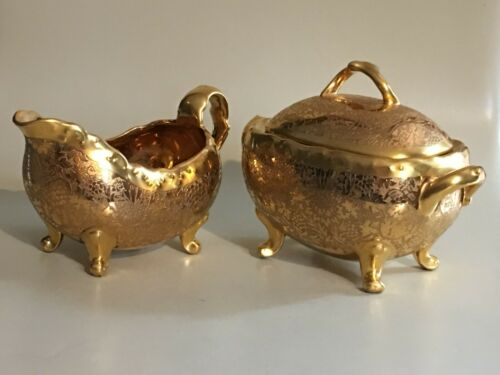 Rare 24 karat gold encrusted hand painted creamer and sugar bowl with lid
