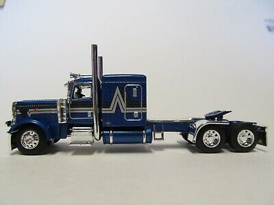 DCP FIRST GEAR 1/64 SCALE 389 PETERBILT FLAT TOP, BLUE WITH BLACK/ SILVER STRIPE 1