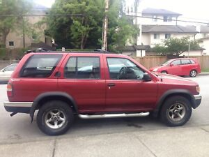 Red 1998 Nissan Pathfinder  $1400 obo
