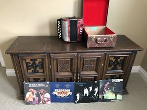 Antique record player and accordion