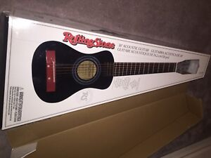 Nice Perfect working condition guitar com With box