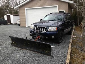 Grand Cherokee Jeep with a plow