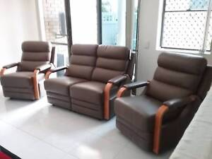 Three piece reclining leather lounge.