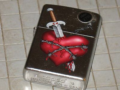 A New ZIPPO Windproof Lighter USA 76944 Knife Thru The Heart Barbed Wire Sword Knife Through Heart