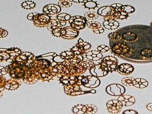 15pc. Tiny metal golden wheels gears charm fairy dust glitter confetti steampunk