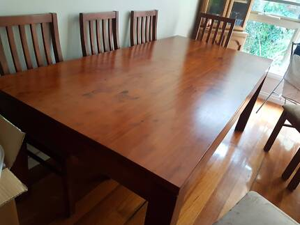 8 seater wooden dining table and chairs