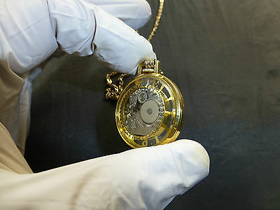 VINTAGE SWISS NECKLACE MECHANICAL WIND UP WATCH SEE THROUGH  ( WATCH THE VIDEO )