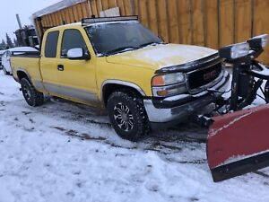 Reduced 2001 GMC truck with western plow