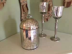 Metallic glass  canister and mantle glasses