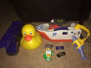 Bath toys and hot wheel truck