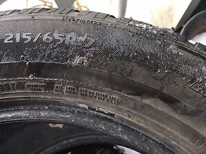 Studded 215/65/17 tires. Excellent condition
