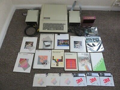 Vintage Apple IIe computer, with disk drives and manuals.