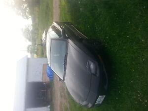 1997 Pontiac Sunfire black Coupe (2 door)