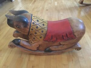 Wooden handcrafted rocking pig