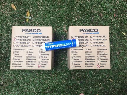 Pasco box of white silicone caulking sealant, 40 tubes.