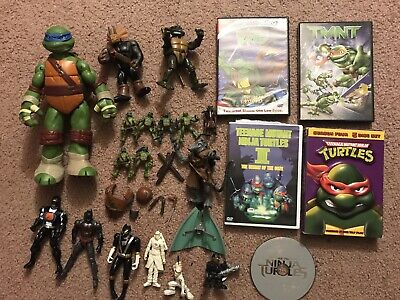 Teenage Mutant  Ninja Turtles Lot Figures, Weapons, And Dvds