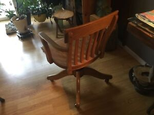 Solid Oak Arm chair , adjustable height on rolling casters