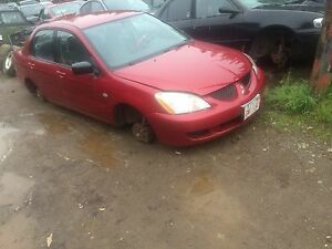 Parting out 2003 Mitsubishi Lancer!!