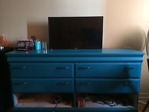 Large dresser used as tv stand.