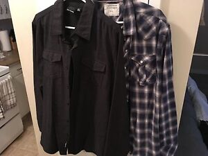 2 shirts large never worn like new must pick up