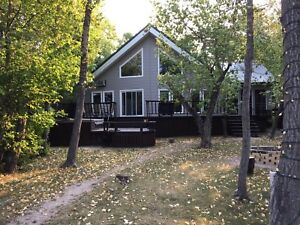 Spacious 3 BR Lakefront Cottage Rental with Hot Tub