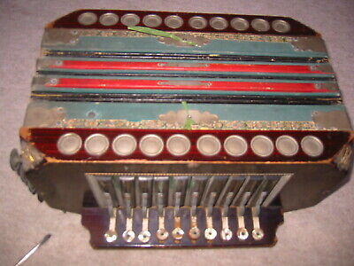 Nice. old diatonic button accordion, 4 coupler at side