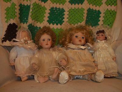 Lot Of 4 Porcelain Dolls