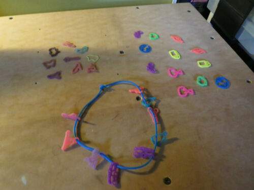 30 Piece Lot Finger Bandz Rings Necklace Charms Silly Crazy