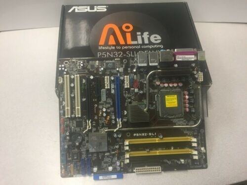 ASUS P5N32-SLI DELUXE Motherboard with accessories.