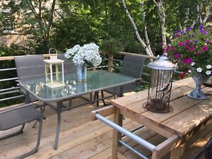 Patio glass table and six chairs
