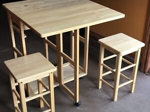 Fold out table with stools- folds into side board