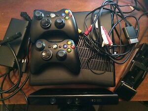 Xbox 360 with 2 controllers and all gadgets needed!
