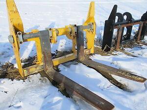CAT and John Deere wheel loader forks, jib booms & pipe grapples