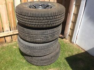 Four steel rims with Goodyear tires