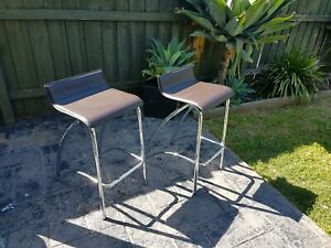 Brown leather and chrome bar stools
