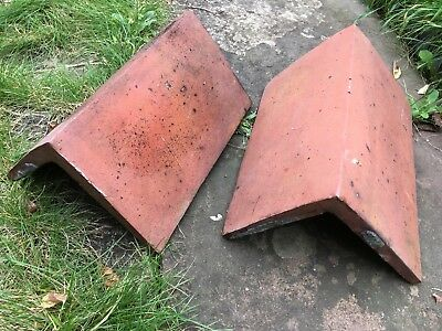 Two clay ridge roofing tiles, salvaged from Victorian House
