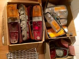 Assorted vintage Volvo lights and lenses