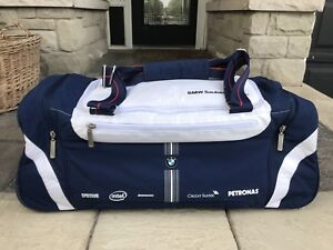 BMW Sauber Formula 1 (F1) rolling duffle and backpack