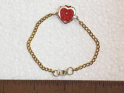 "BRACELET GOLD COLOR METAL HEART RED PLASTIC 1 ¾"" DIA. CLASP LOOKS MAKESHIFT CHIL"