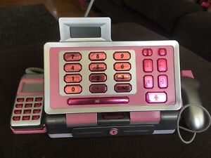 White and pink cash register toy